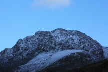 An extreme close up of Tryfan's snowy summit