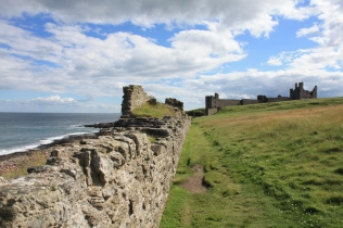 Dunstanburgh's walls still protect the castle, if only there was anything inside to protect